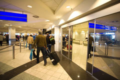 Traveling people at the airport Royalty Free Stock Image