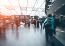 Traveling people in motion blur Royalty Free Stock Photo