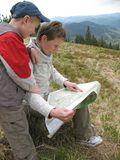 Traveling people reading map on mountains Stock Photo