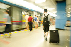 Traveling people at the subway station in motion b Royalty Free Stock Photography
