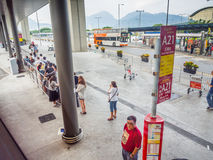 Traveling people waiting for city bus at Hong Kong airport bus station Royalty Free Stock Images