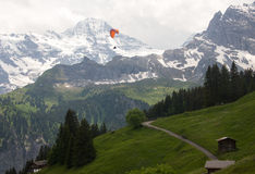 Traveling. This is a photo of a paragliding over the cliff in Switzerland Stock Photos