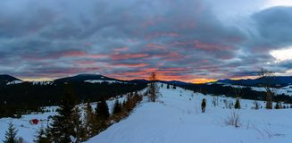 Traveling photographer admires the beautiful sunrise on the top of Carpathian mountains stock photography