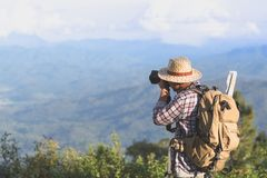 Traveling and photography. Young man with camera and backpack ta stock photos