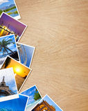 Traveling photos on wooden table Royalty Free Stock Photo