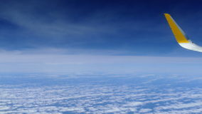 Traveling by plane above the clouds, top view. Traveling by plane above the clouds, with sea and sky background, seen from above stock video footage