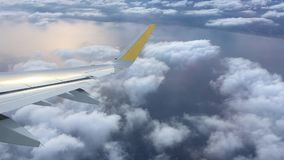 Traveling in plane. Mediterranean sea surface, plane wing and clouds stock footage