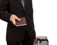 Traveling pulling suitcase and holding passport Royalty Free Stock Photo