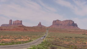 Traveling the Road to  Monument Valley. The highway leading to scenic landscape in monument valley tribal park near Kayenta Arizona stock footage