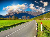 Traveling the roads of Frence. Sunny morning in alpine meadows. Alps, France Royalty Free Stock Image