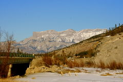 Traveling in rocky mountains. Jasper national park, alberta, canada, good sunny weather, frozen river Royalty Free Stock Image