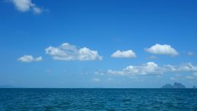 Traveling through the sea clear blue sky. Still camera stock footage