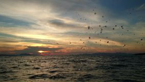 Traveling through the sea splashing water sunset. Traveling through the sea splashing water cloudy twilight sunset stock video footage
