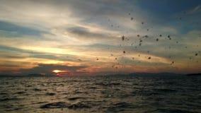 Traveling through the sea splashing water sunset stock video footage