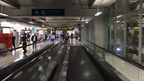 Traveling on the sidewalk in the airport with haste. Traveling on the sidewalk in Asia Airport Video Time lapse stock footage
