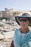 Traveling smiling senior lady stock photo