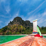 Traveling at Thai traditional boat. Thailand tropical beach Royalty Free Stock Photos
