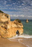 Traveling to amazing stunning sea caves cliffs on sandy camilo beach in blue sky Royalty Free Stock Image