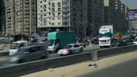Traveling to Kairo. EGYPT - APRIL 28: Traveling through cityscape on highway in Egypt stock video