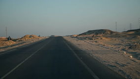 Traveling to Kairo. EGYPT - APRIL 28: Driving on a deserted road in sunset stock video footage