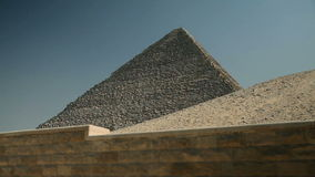 Traveling to Kairo. EGYPT - APRIL 28: Pyramid from below with blue sky stock video footage