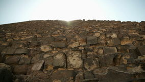 Traveling to Kairo. EGYPT - APRIL 28: Pyramid huge bricks with sun shining above stock video footage