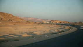 Traveling to Kairo. EGYPT - APRIL 28: Traveling on road through Egypt at sunset stock video footage