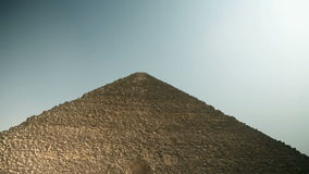 Traveling to Kairo. EGYPT - APRIL 28: Tilting wide shot of pyramid from below stock footage