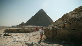 Traveling to Kairo. EGYPT - APRIL 28: Woman posing in front of pyramid stock footage