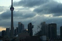 CN Tower and urban surroundings. Traveling through a Toronto Ont. a city at the end of the day Stock Images