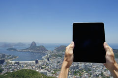 Traveling Tourist Holding Tablet at Rio de Janeiro Brazil Skyline Royalty Free Stock Photography