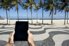 Traveling Tourist Using Tablet Copacabana Rio de Janeiro Brazil Stock Image