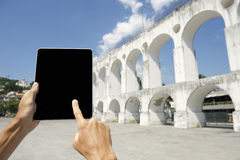 Traveling Tourist Using Tablet at Lapa Arches Rio de Janeiro Brazil Stock Photo