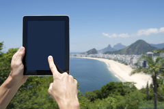 Traveling Tourist Using Tablet at Rio de Janeiro Brazil Beach Royalty Free Stock Images
