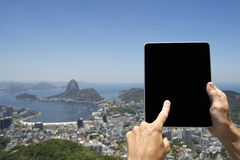 Traveling Tourist Using Tablet at Rio de Janeiro Brazil Skyline Stock Photography
