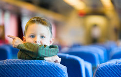 Traveling by Train. Cute 4-years old boy traveling by train Stock Images