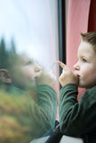 Traveling by Train. Cute 4-years old boy traveling by train Royalty Free Stock Image