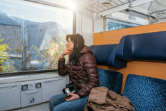 Traveling by train at the Alpine Railroad. Royalty Free Stock Photo