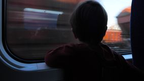 Traveling by train. Boy at train. Cute 5 years old boy looking through the window in the train. Traveling with children