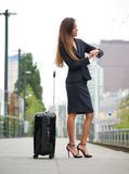 Traveling by train and checking time Royalty Free Stock Image