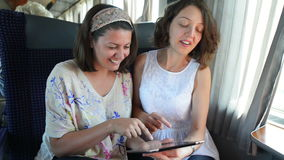 Traveling by Train. Two women enjoying travel by train stock footage