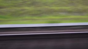 Traveling by train, view through window. Traveling by train, view of the railway through the window of fast moving train vehicle, motion blur rails as concept of stock video