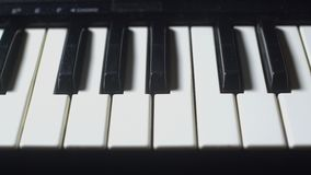 Traveling that travels the keys of a piano. Traveling that runs the keys of a black and white piano