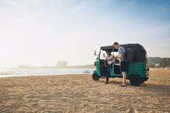 Traveling by tuk tuk taxi stock images
