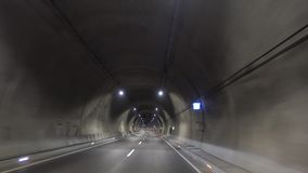 Traveling in the tunnel, transportation, travel. An artificial underground passage, especially one built through a hill or under a building, road, or river stock video footage