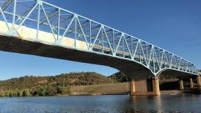 Sailing Under a Bridge Under Construction On the Ohio River. 9327 Traveling under a bridge that is under repair on the Ohio River stock footage