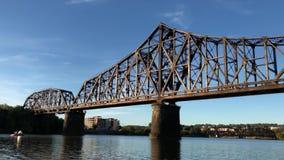 Traveling Under Railroad Bridge On the Ohio River. 9328 Traveling under a railroad bridge on the Ohio River in Western Pennsylvania stock footage