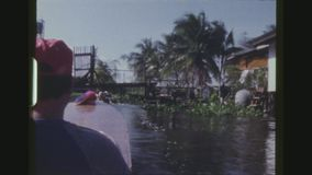 Traveling Up The River Kwai. THAILAND, BANGKOK, DECEMBER 1983. Five Shot Sequence Off A Boat Traveling Up The Khwae Noi River. Children Swimming And A Woman stock video