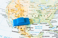 Traveling in USA. Traveling concept - blue toy car on the map of the USA Stock Image