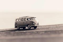 Traveling vintage camper van. Macro photo. Sepia toned image Royalty Free Stock Photography